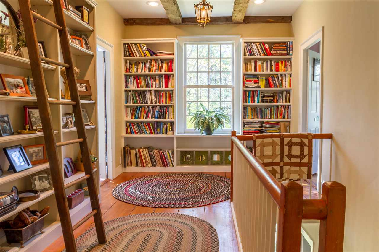 Upstairs hall with built-in bookshelves