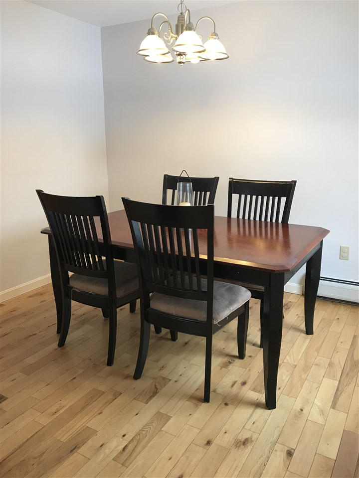 Dining area with hardwood floors