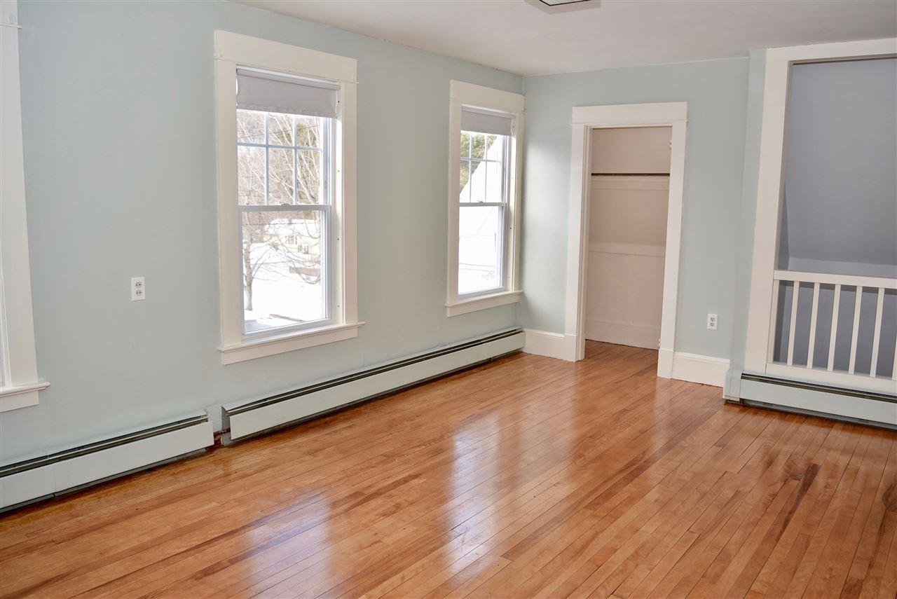 Bedroom w/ refinished floors
