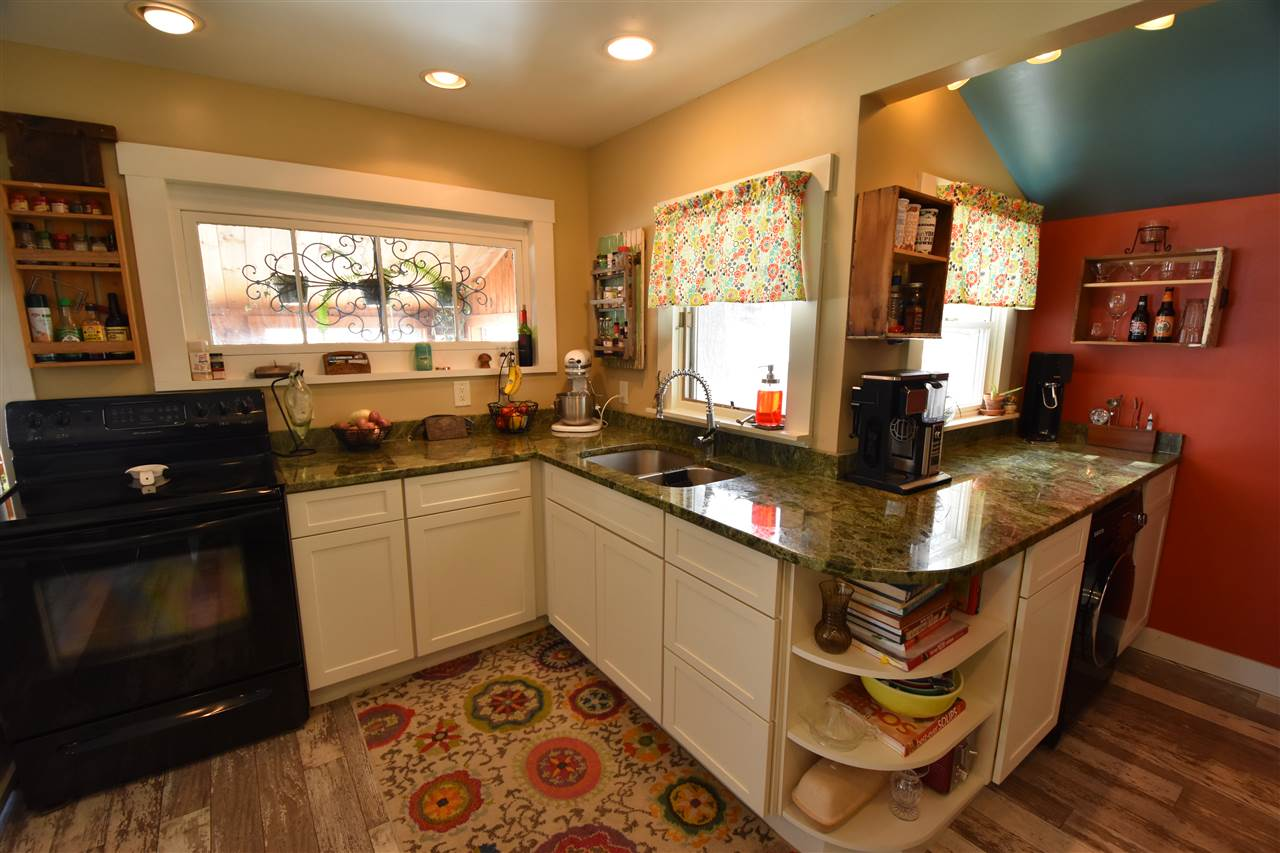 Exotic granite countertops, high end laminate flooring and new cabinets... 11592693