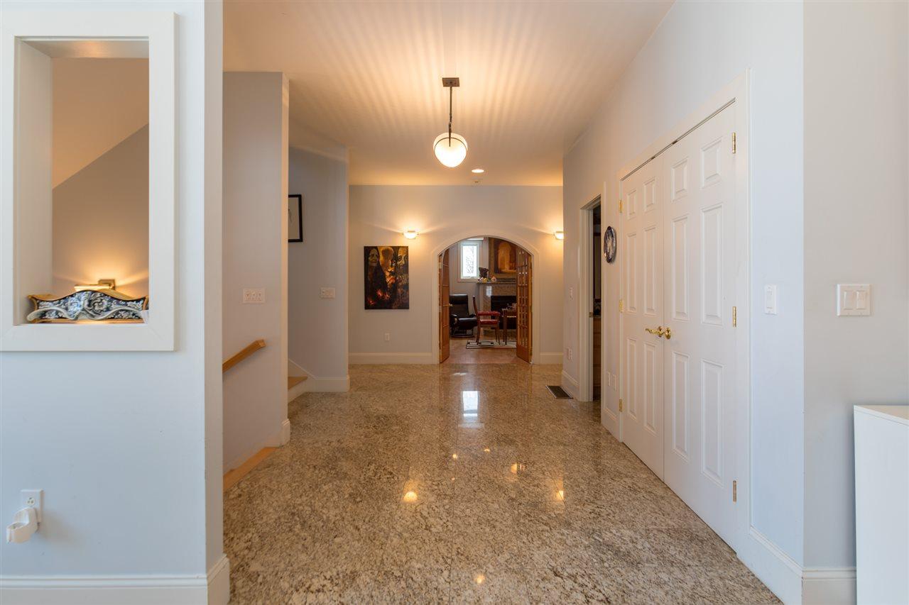Hallway to first floor bedrooms, with 1/2 bath 11684306