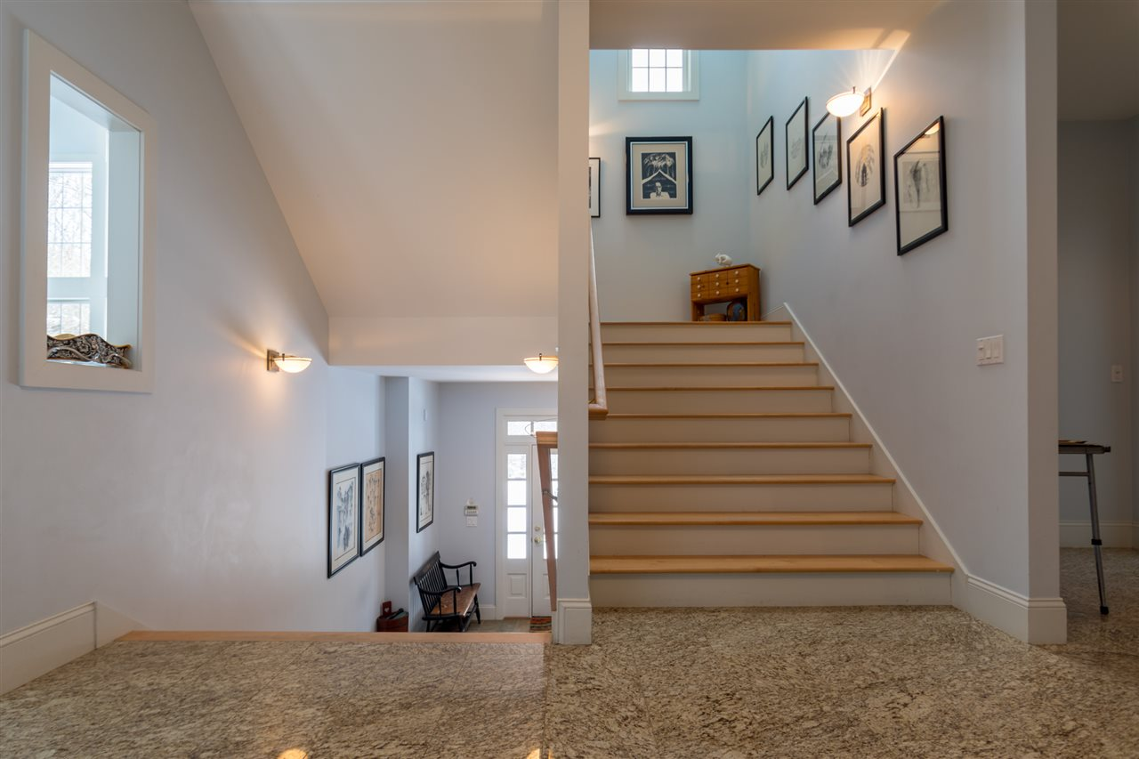 Wide stairway to the second floor bedrooms 11670850