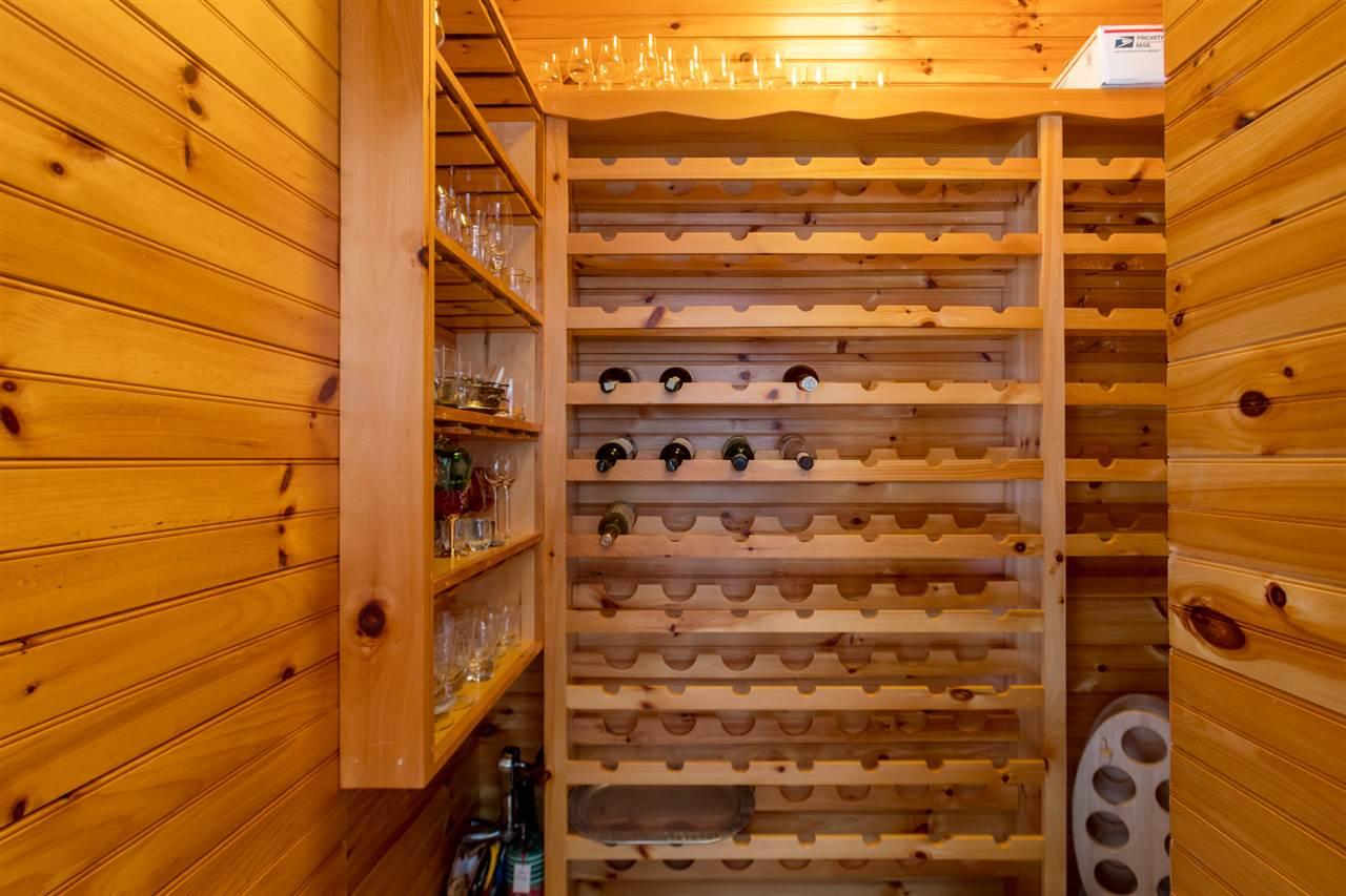 Walk in wine closet in kitchen 11685174