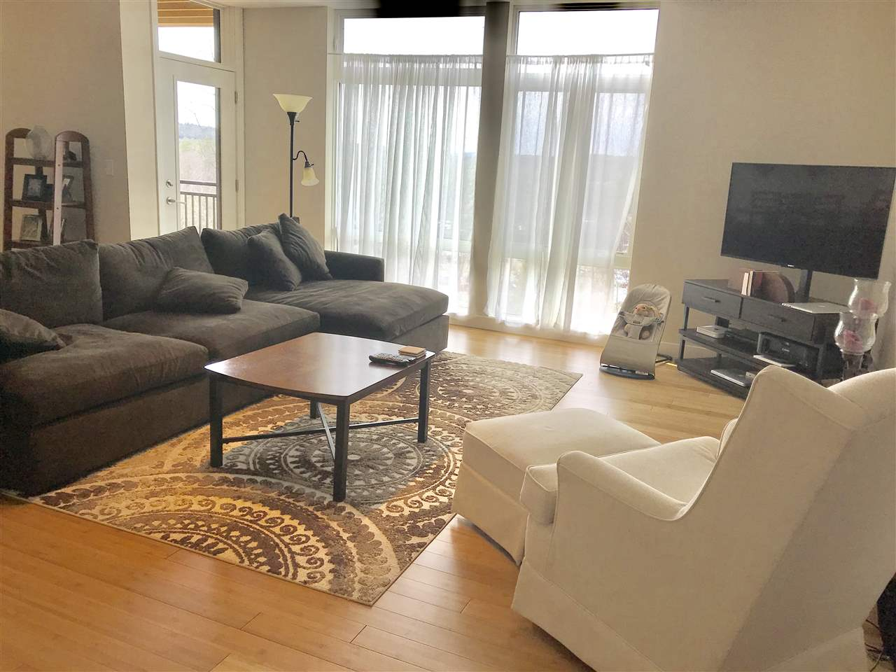 Spacious living room with access to deck with views