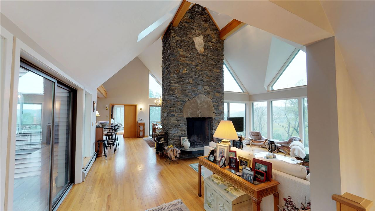 Soaring floor to ceiling stone fireplace 11875325