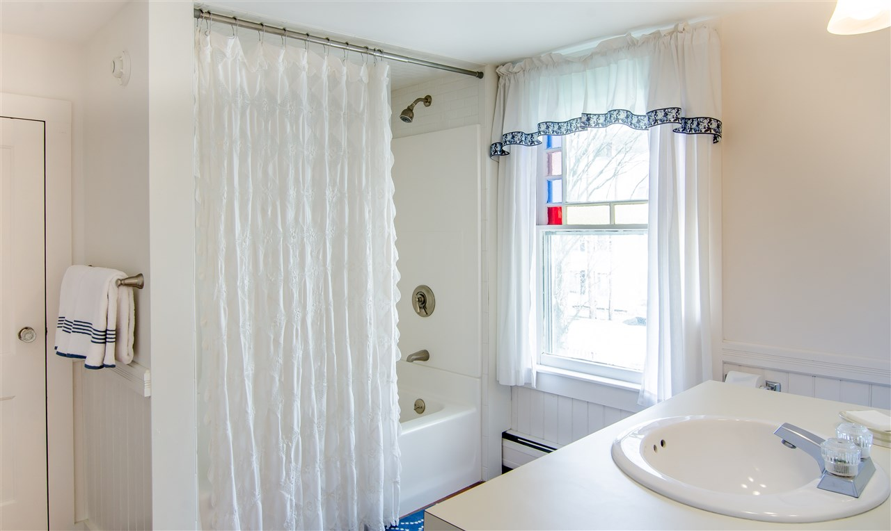 Stained glass window in master bath 11825648