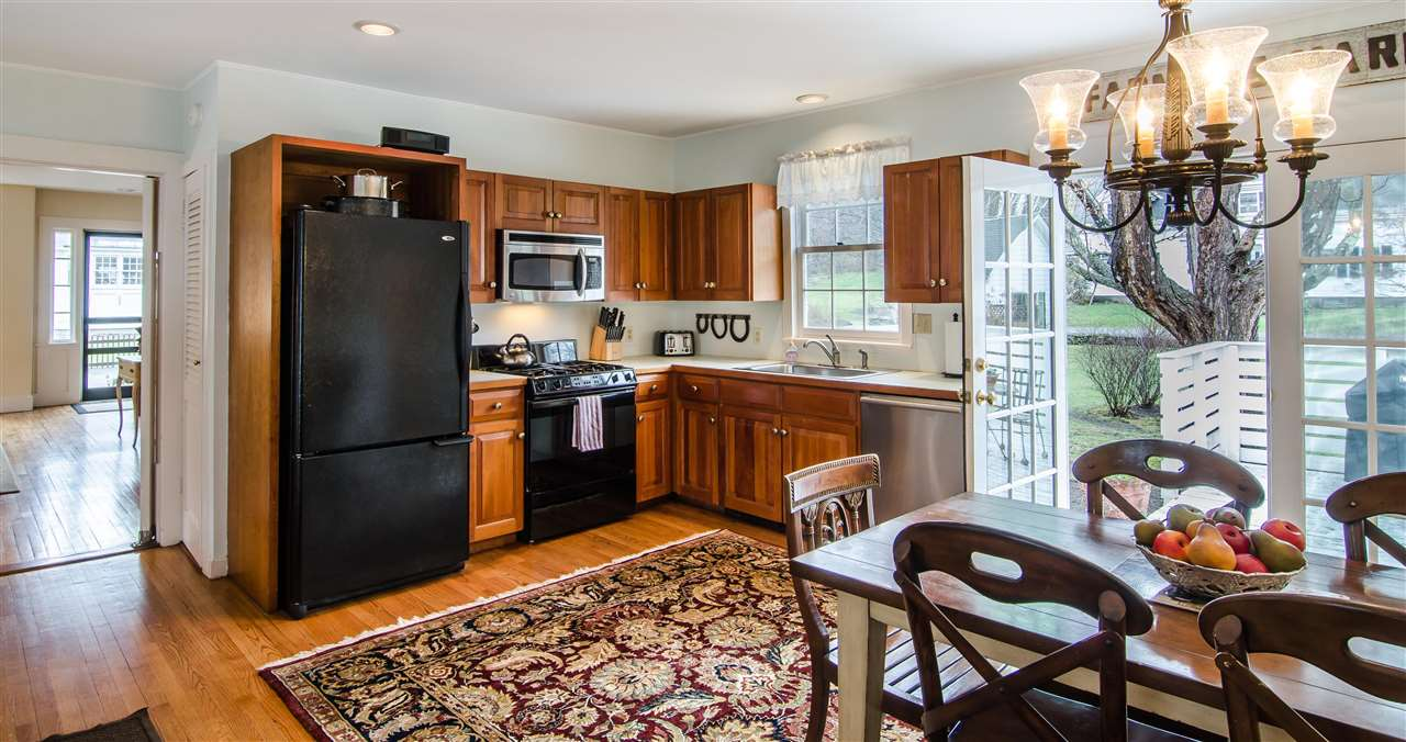 Kitchen opens onto sunny deck and yard 11825665