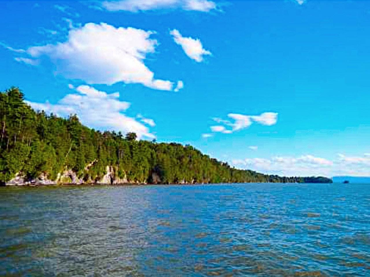 Have you ever dreamed of building the perfect home on Lake Champlain? This 24.8 acre parcel of land is just what you're looking for. Preliminary septic work shows 4+ bedroom possible. Over 800 feet of Lake Champlain shoreline on Button Bay. Stunning views that WOW with a feeling of peace as you experience the sun setting over the Adirondacks. Exploring this land will present mixed, mature hardwoods, abundant wildlife and breathtaking scenery! Stop dreaming and start living, because...there's no place like home!