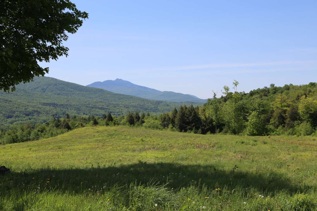 Long Range views that include Mt Mansfield and the Lamoille River Valley! Already 4 building lots approximately 2 acres each with State Waste Water permit for building. More lots possible or keep the remaining 100 acres for your private retreat at the end of the road for top of the world panoramic views! Only 15 minutes to Smugglers Notch Resort, 30 min to Stowe, and 40 Min to Jay Peak. Central to Morrisville, St Albans and Burlington – home of many breweries too! Montreal is only 1.5 hours and 4 hours to Boston.  Investment opportunity!