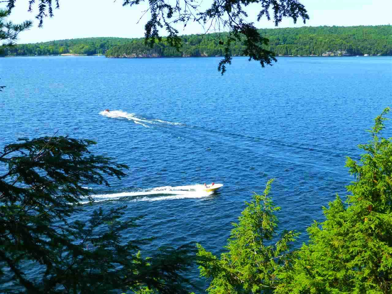 """Lake views with clearing subject to any waterfront restrictions. Build a dream waterfront home with Lake Champlain lot frontage. Very close to Burlington but private feeling wooded lot. Association dues to the Sunset Estates of $250 a year for lots and $450 a year for houses. See requirements of the driveway in the attachments. Small overgrown """"lane"""" bisects the lot connecting the roads (Miller Road and Basswoood - Stapleton Road) on either side of the lot. All figures like the road frontage are estimates."""