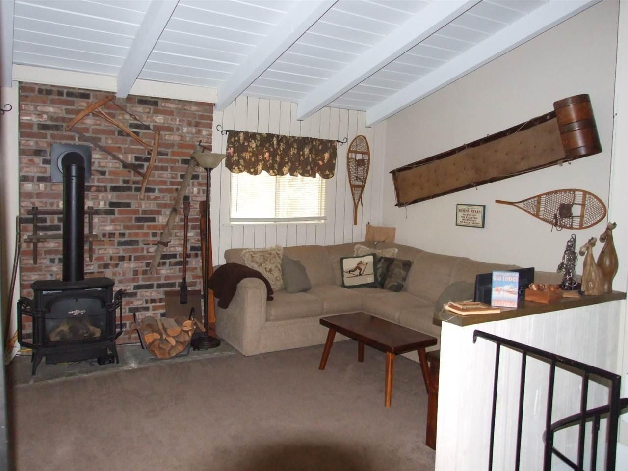 Spacious Living Room with propane stove. 12016406