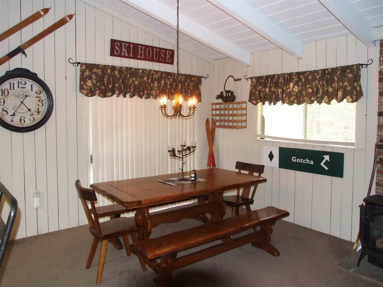 Dining area opens to covered porch. 12016408