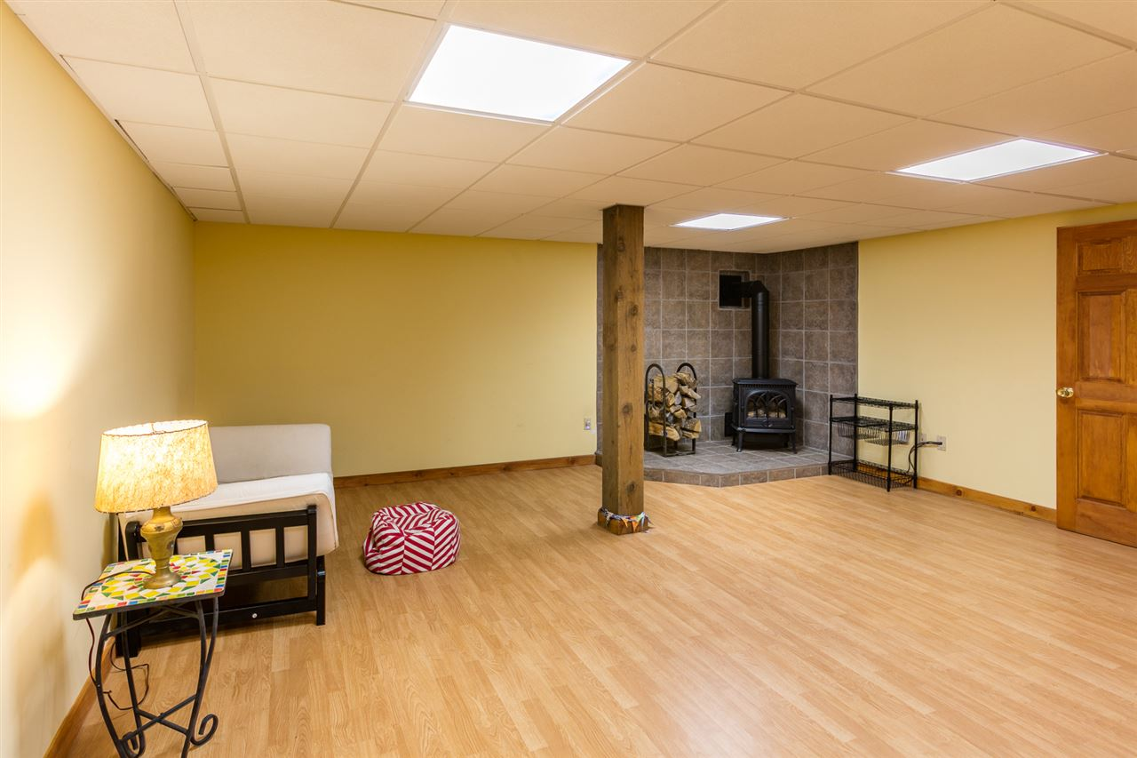 Finished room in basement with woodstove