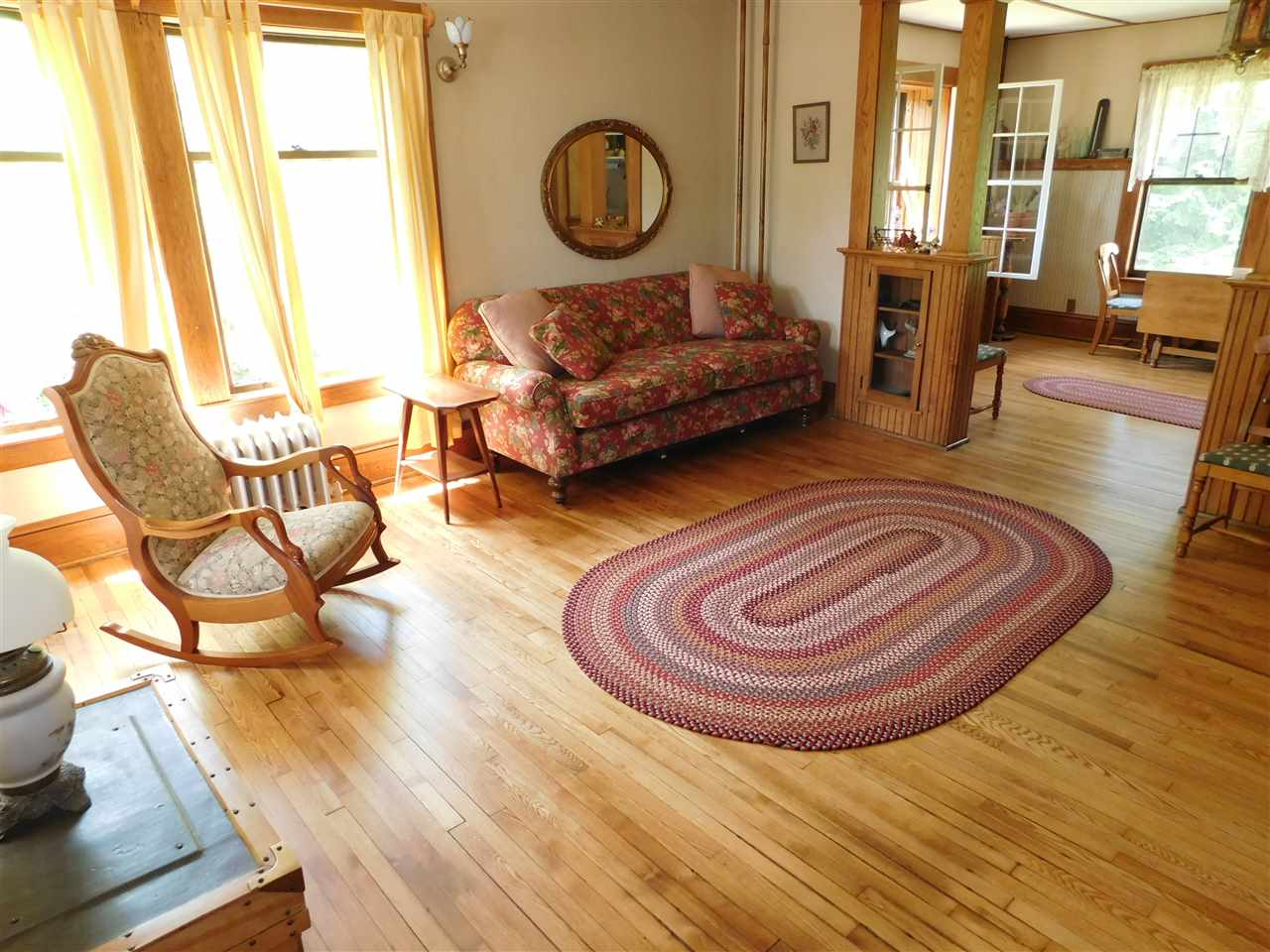 Sun Filled (16 x 16) Living Room, with Gorgeous Hardwood Floors! 12114274