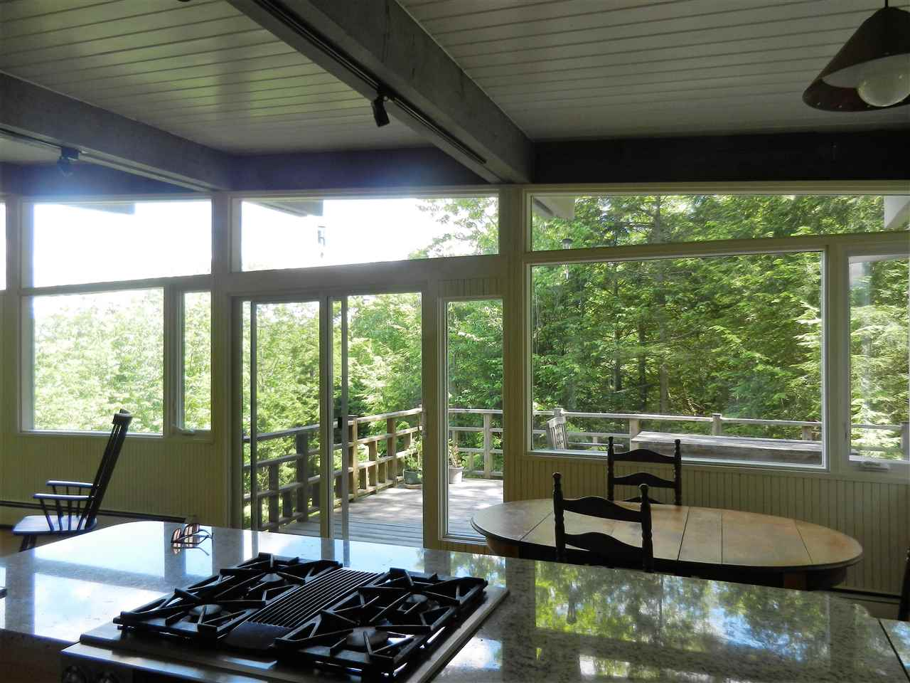 View across kitchen counter to back deck