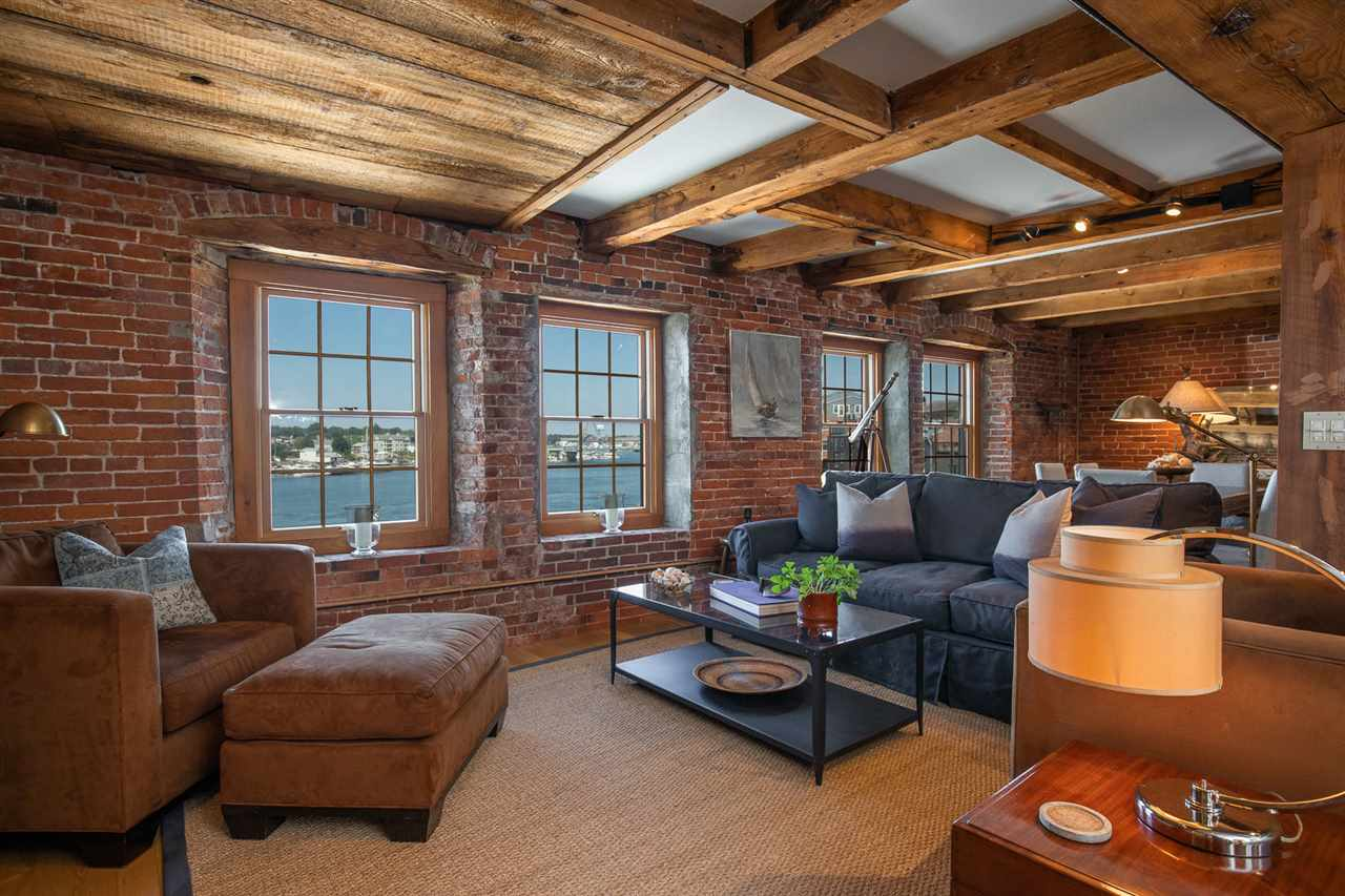 From the moment you step into this historic downtown Portsmouth condo, you are greeted with breathtaking views of the Piscataqua River, the Portsmouth tugboats, and timeless scenes of Ceres Street.  This 2 bedroom third floor condo offers one-level living, an open floor plan, and modern finishes, while also featuring stunning wood floors, exposed brick and original beams throughout.  A pristine, updated kitchen with accompanying breakfast bar abuts the formal dining space that provides sprawling views of the waterfront.  The spacious master suite is a private oasis, boasting a spa bathroom with soak tub and modern shower.  Historic brick runs throughout the interior, pairing perfectly with the tasteful decor.  No transportation is needed here as you step out your doorstep on Merchant's Row into the heart of Portsmouth with surrounding restaurants, shops, art galleries and entertainment.  A perfect blend of modern amenity and historical charm, this highly sought after location is a rare downtown offering. Don't miss this chance to become part of a charming & thriving Portsmouth community!