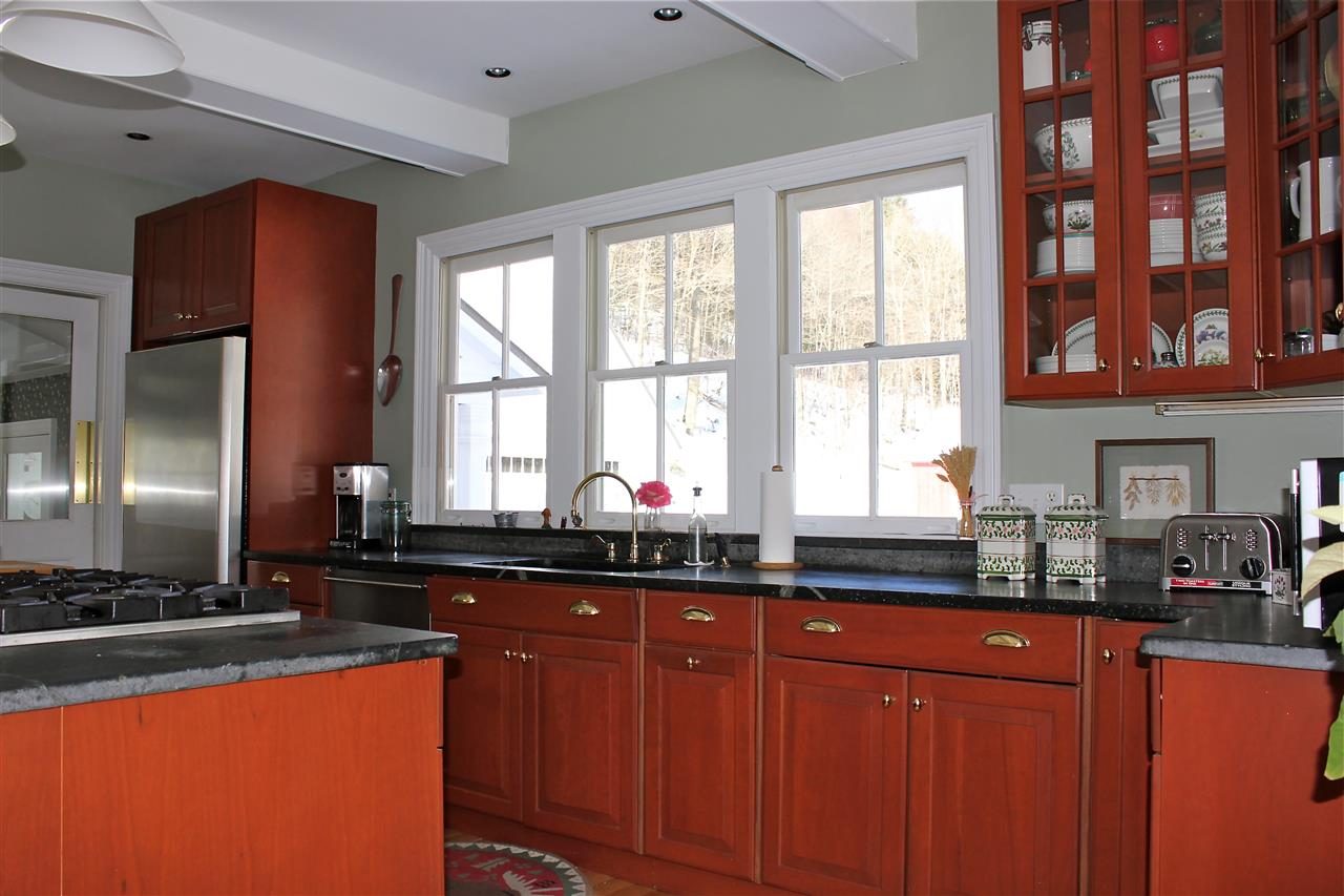 kitchen with cherry cabinetry 12242425