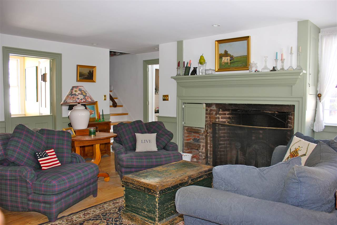 living room with Rumford fireplace 12242489