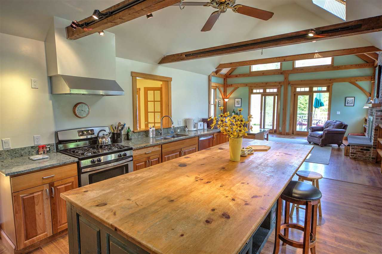 Open concept kitchen with eclectic blend of rustic modern! 12247357