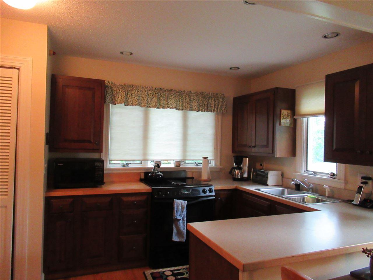 Kitchen overlooking stream 12250235