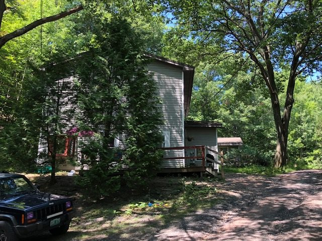 A duplex on 22 acres!  Mostly wooded.  Some potential for limited development.  Great potential for your home with the duplex to pay the bills!  All this close to the interstate and services.