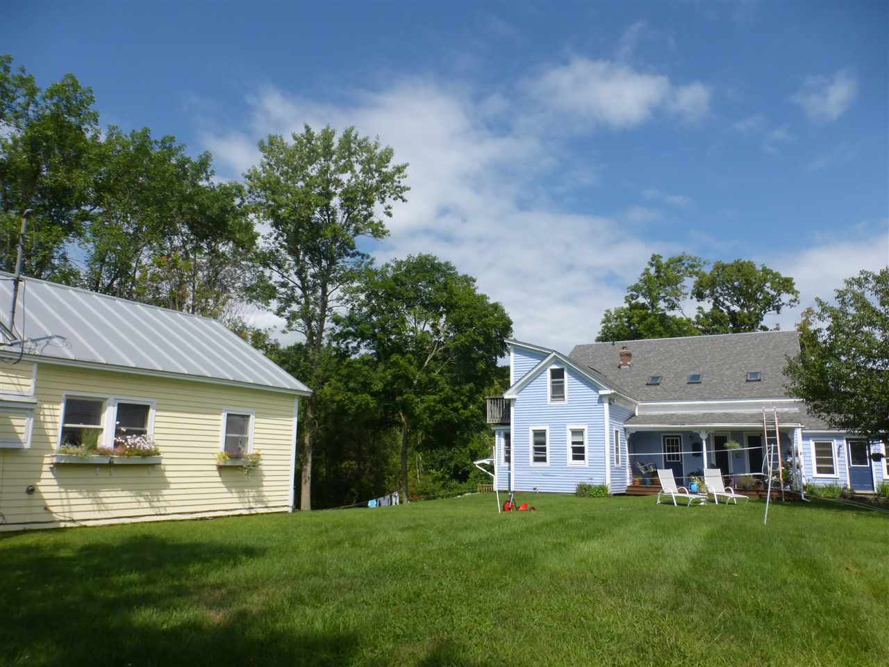 Unique Middlebury opportunity to have income from one or both houses on the 1A parcel in the country with Green Mountain views.  Very versatile the contemporary farmhouse features a 1 BR in –law suite which can be just that or used as an Air BNB.  It has rented for $850/mo. or between $50-$89 per night.  The one level ranch house has 1 bedroom, 1 bath & rents for $1,025/mo.  Current tenant is month to month.  The fun & eclectic farmhouse has interesting angles, skylights, windows & rooms, with 2 bedrooms & 2 baths.  It also has 2 decks & south facing porch great for enjoying the 1 A yard.  Plenty of room for gardening.  Attached workshop on the south end of ranch.
