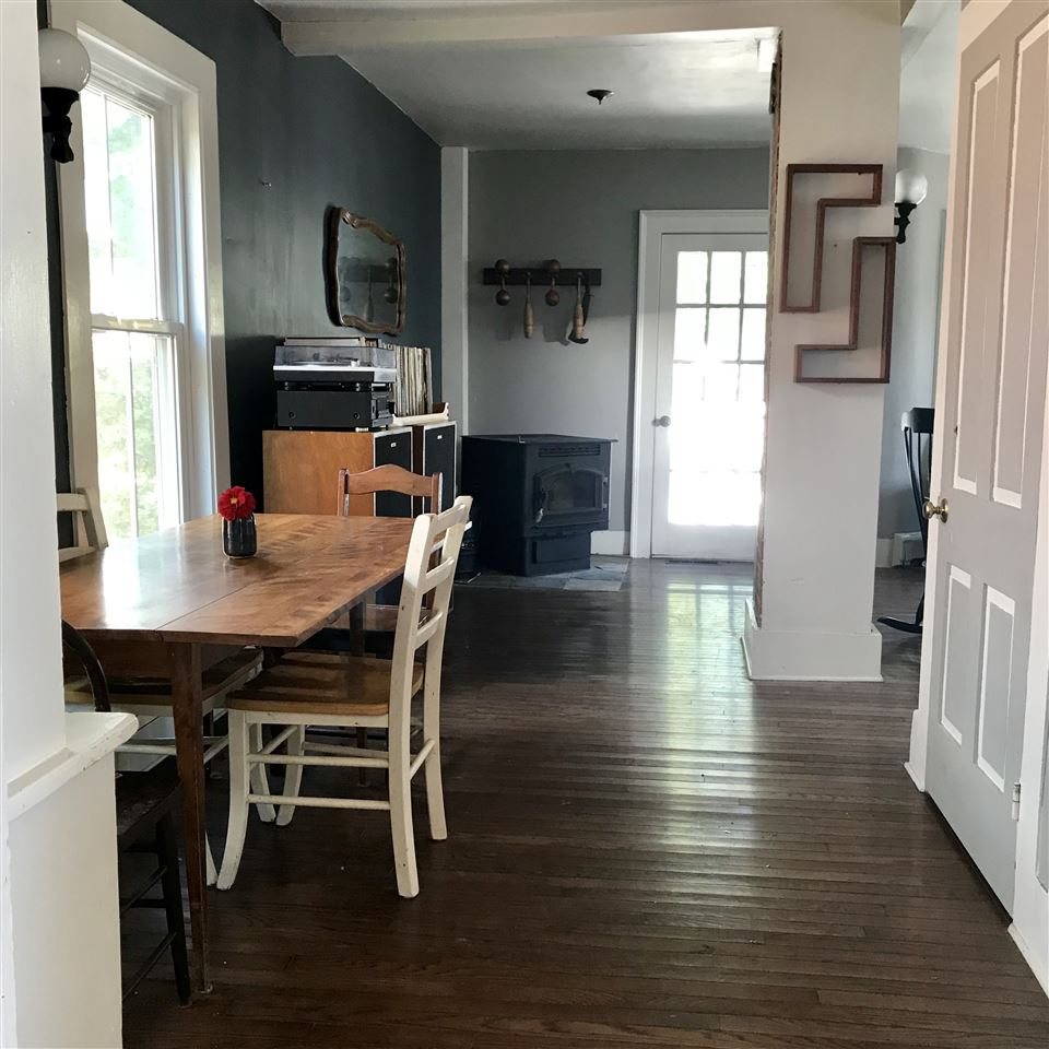 Open Living and Dining Room with Built-Ins