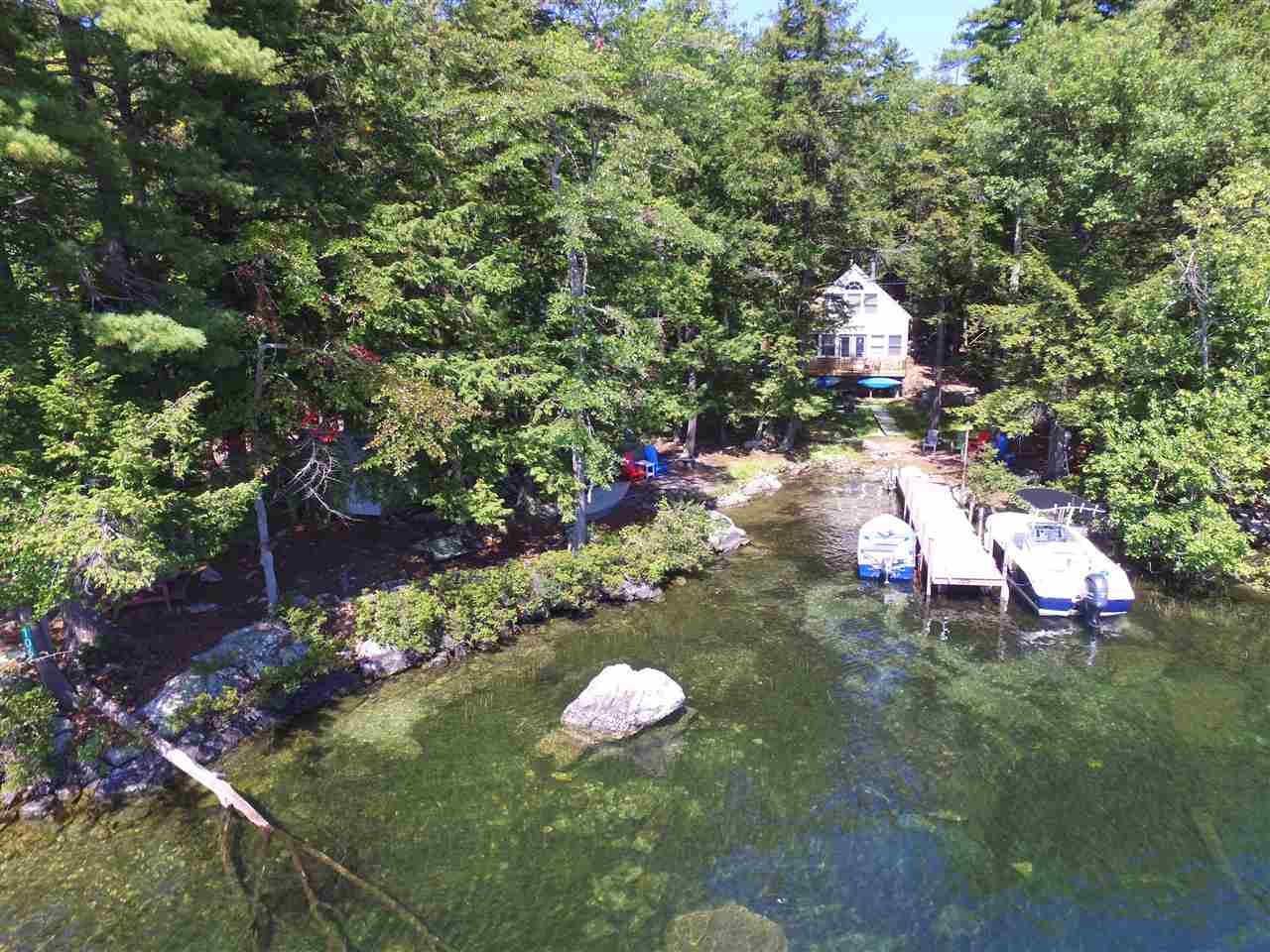 VILLAGE OF MIRROR LAKE IN TOWN OF TUFTONBORO NH  Home for sale $365,000