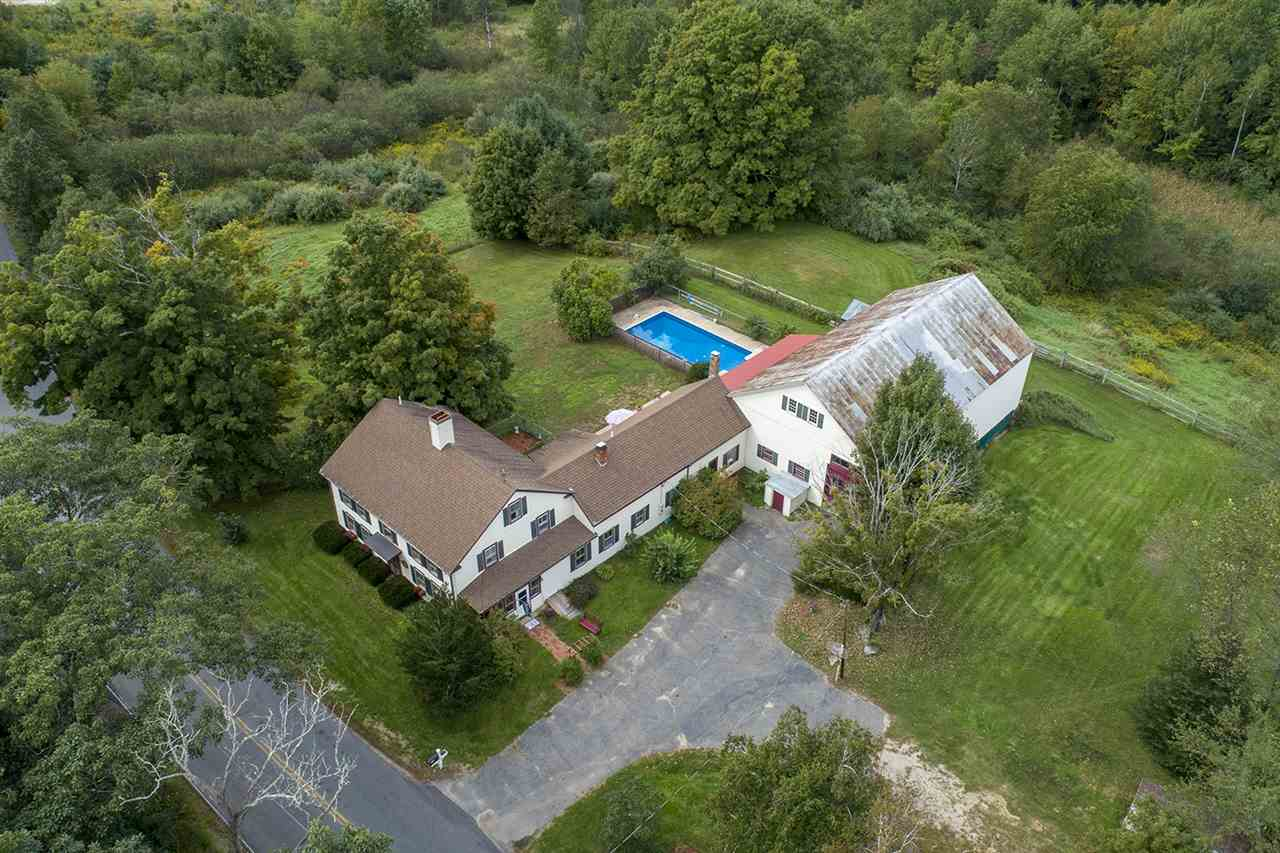 Spacious home with 60'x30' attached barn, brew house, inground pool, screened porch and much more!