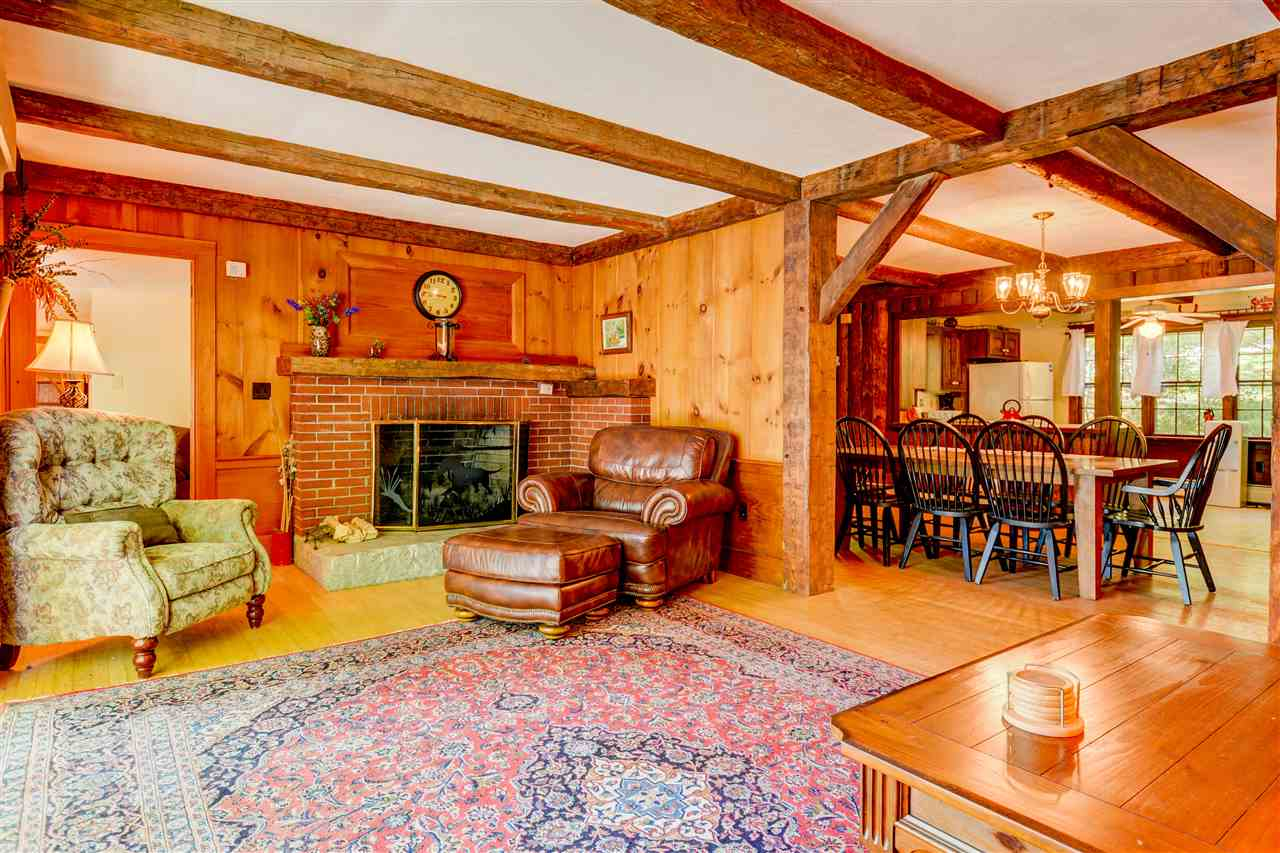This wood work on the interior adds to the abundant charm of this property. 12875864