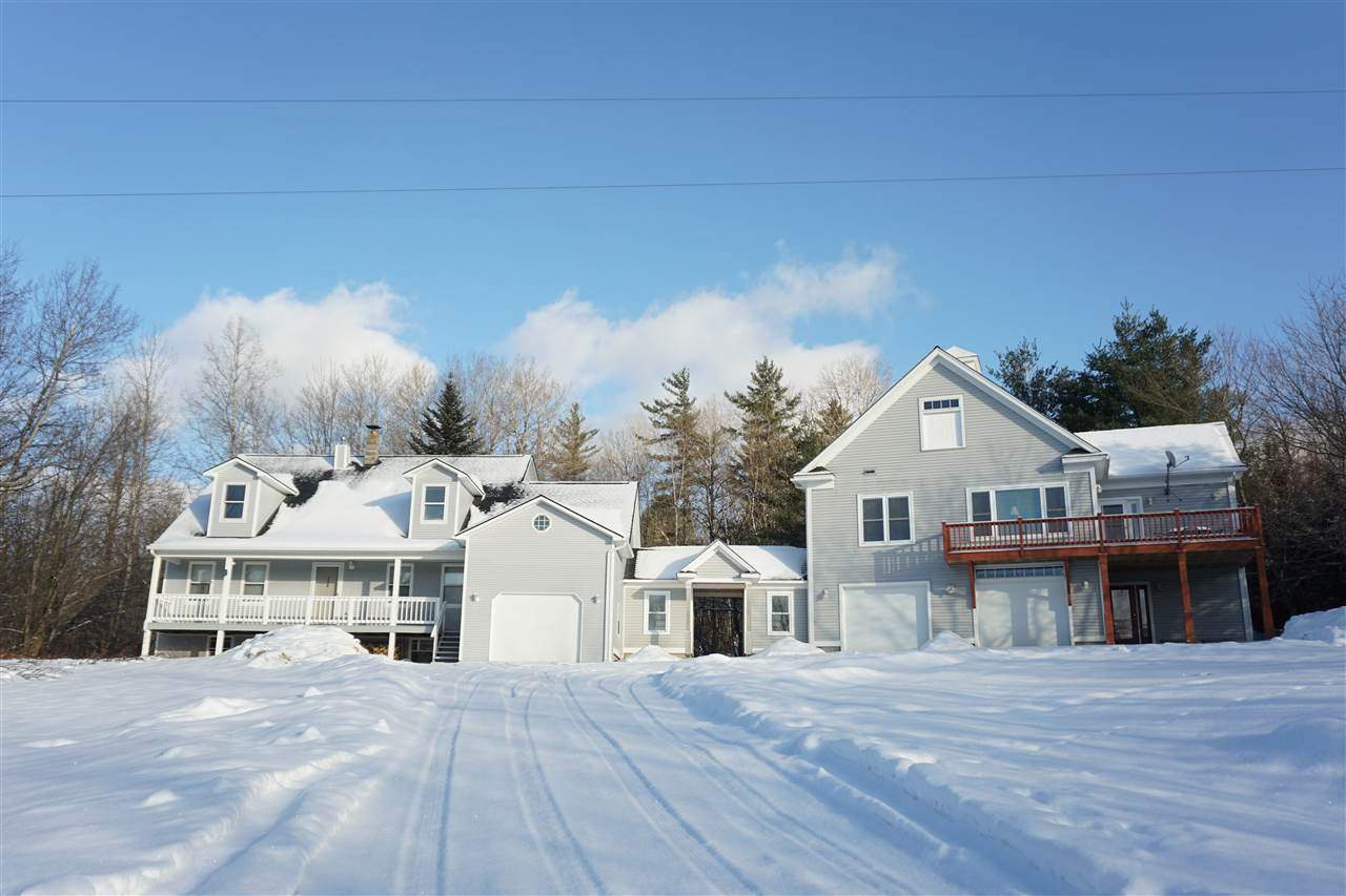 3 bedroom newer farmhouse style home with updated and modern 3 bedroom barn apartment.  Beautiful mountain setting with just over 10 acres. Amazing sunset views over Camels Hump. 5 car garage parking. This meticulously cared for home features a massive kitchen with island. Sunroom with amazing natural light. The main living area features a gas fireplace and wonderful picture window. First floor also features a separate den nearby the new ¾ bath with walk-in shower, laundry. Upstairs boasts 3 good-sized bedrooms and 2 full baths including a master suite with walk-in closet and ensuite bath. There is a large basement which is half finished featuring two large view windows and acoustical ceiling tile.  You will fall in love with the detached apartment featuring an open concept living room with gas wood stove, modern kitchen and deck. 2 full baths, 3 bedrooms and hardwood flooring throughout. This property is an outdoor enthusiasts dream! Relax on the farmers porch, soak in the sun on the back deck surrounded by acres of privacy, or enjoy a warm fire at the fire pit! 25 minutes to Sugarbush or Bolton. 10 minutes to Camels Hump State Park. The Long Trail is a 5 min walk from your backyard. Short commute to Burlington or South. Amazing country town that feels like home! See virtual tour link above!