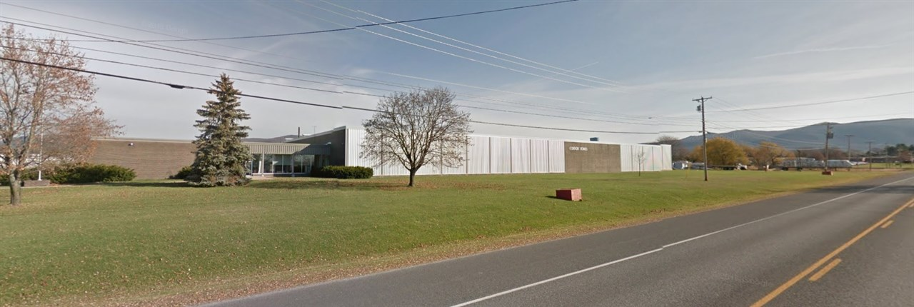 A unique property with vast potential. This 116,000 square foot building offers a mix of retail, warehouse, manufacturing and office space. The warehouse/manufacturing space has 17' clearance and column spacing is 40' X 60'. Situated on 19.2 acres of land with additional land for parking and outdoor storage. Previously occupied by Connor Homes. Excellent parking and 1,200' of road frontage on Route 7 that is great for many commercial uses. Located just outside of downtown Middlebury in close proximity to shops, restaurants and other amenities. Approximately 15,000 SF of existing office space, additional office space can be added. 200 Existing parking spaces with expansion potential.  Offered Warehouse/Manufacturing/Retail: $5.00/SF NNN Office Space: $10.00/SF NNN Type: Office/Manufacturing/Warehouse/Retail Square Footage: 15,000 - 116,000 +/- SF