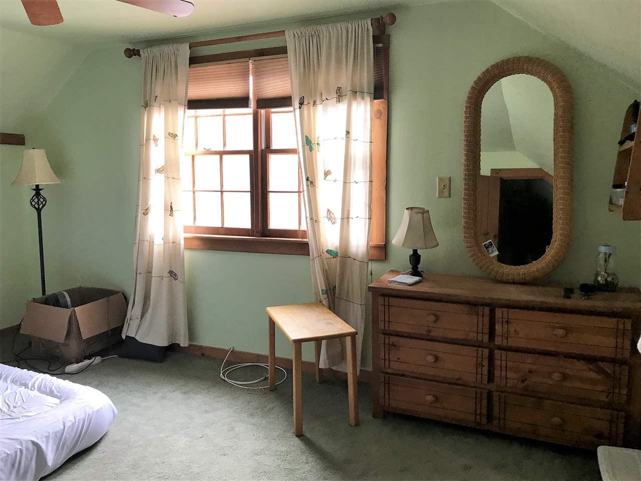 Second floor bedroom over looks back field 12990880