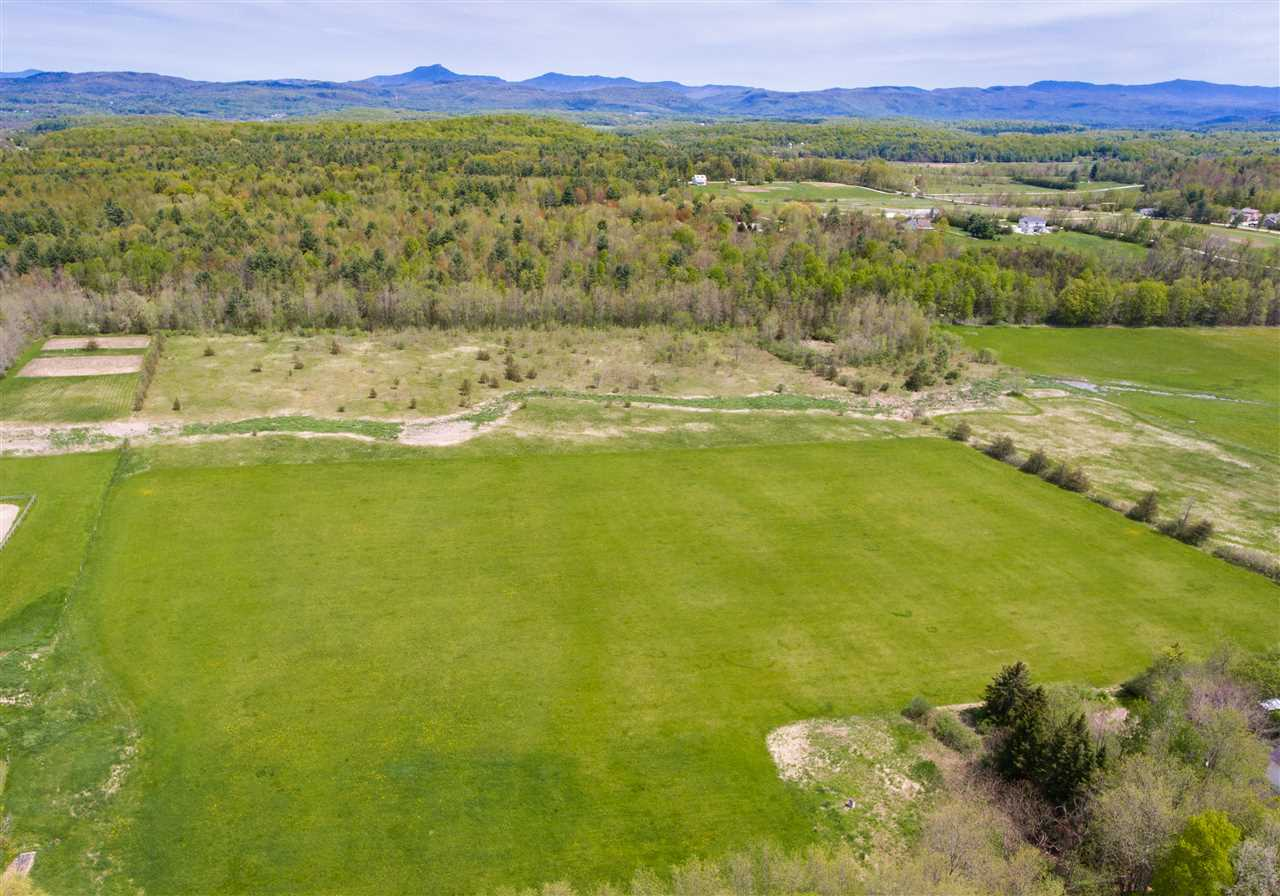 This is one of those rare pieces of land owned for generations. The western open meadow is sunny and currently being hayed by the Lewis Creek Organic Beef farmer.  The entire parcel is in Vt Current Use. The State of VT will allow a portion removed from Current Use to build a home with a small fee owed to the State for that portion being removed.  Vt Current Use gives a discount on property taxes. The real secret is a gentle sloping ridge with lovely woodlands and views to the west (once a building envelope has been cleared). Or build in the sun drenched meadow with extensive solar power advantages. The land reaches to the east with the potential for east views also. A pond is located on the northeast corner.  Soil data is available - 12 bedrooms of potential septic. Walking the land is a must for full appreciation! Approx 20 acres open meadow-30 acres woodlands that would be easy to clear.  The State Wetlands has been to the property in 2013 and a driveway could be built over the small wetland area. Wetland Permits would be needed.  This property has engineer soil data and other documentation.  The driveway entrance provides access to the small house to the north via a Right of Way.  This property is perfect for a wonderful Vermont lifestyle building in the meadow or on the ridge looking to the views and out to the meadows  The property on the east side does abut a protected wildlife corridor and will need to be conserved.