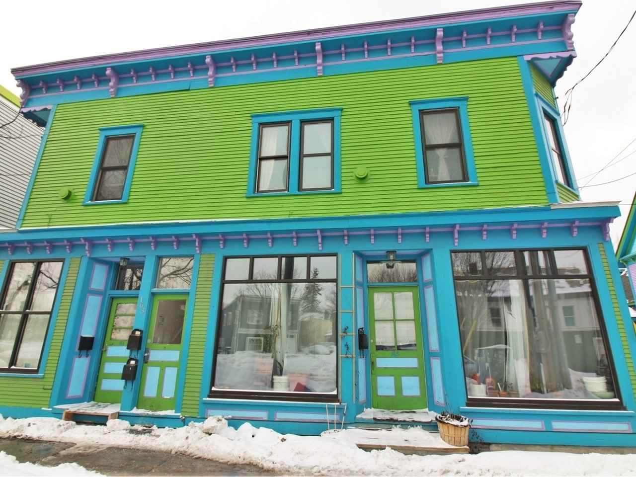 Located in the heart of the historic Old North End, this converted turn of the century store front offers four stunning apartments with updated kitchens, hardwood floors, stainless appliances and remodeled bathrooms. Configured with two studios, a 1 Bedroom and a 3 bedroom apartment with off-street parking and close to hospitals, colleges, and downtown Burlington.