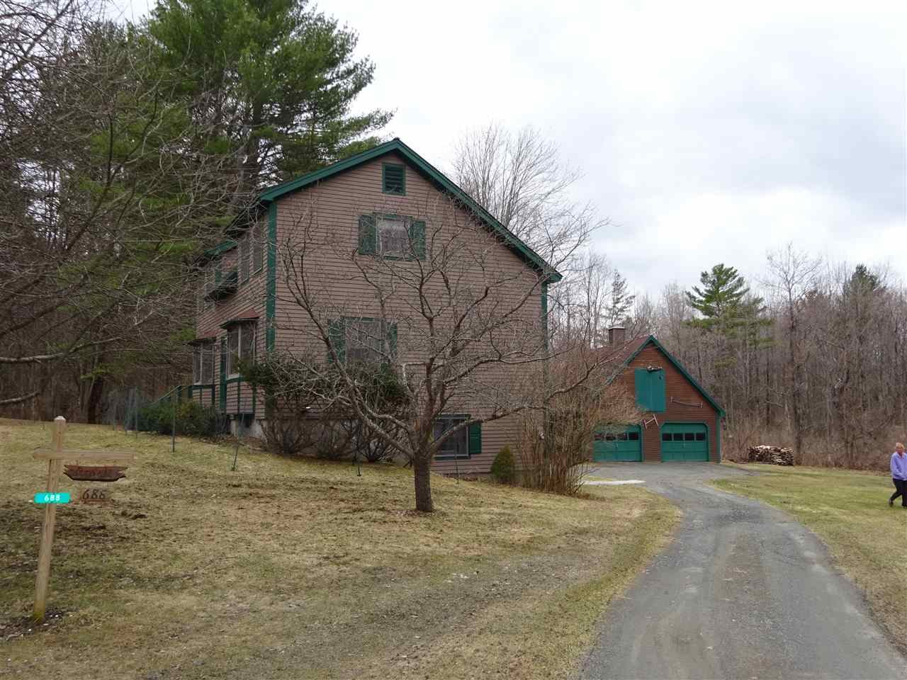 Well built home on 3.5 private acres abutting the West Windsor Town Forest and Mt. Ascutney.   Excellent light.  Open kitchen dining area.  Bedrooms are large with ample storage.  The walk out basement has 440 sq. ft finished.  Used as an office now but could be a guest room, rec room etc.  There is a 1 bay garage under currently used for a woodworking shop. Many other uses are possible.  An attractive 30x26 detached garage has room for 3 vehicles plus equipment & toys.  Storage up.  Views over rolling meadows.  Wildlife pond.  Tree fort.  All located 'on the trails' at the end of Mile Long Field.  Endless hiking ,biking and outdoor recreation await.  Protective covenants