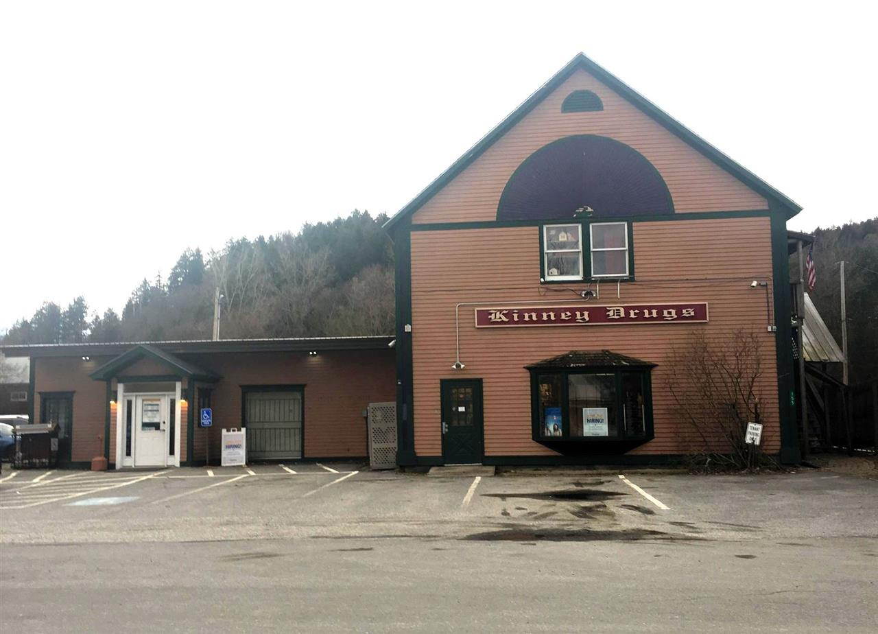 1.01 Acres with Commercial Building. Lower Level currently leased to Kinney Drugs. Two Apartments upstairs. One 1 bedroom unit, One 2 bedroom Unit.  Paved Parking in front and additional parking to the side of the unit. Back yard for tenants use with lawn and garden space.  Lease and financials available upon request.