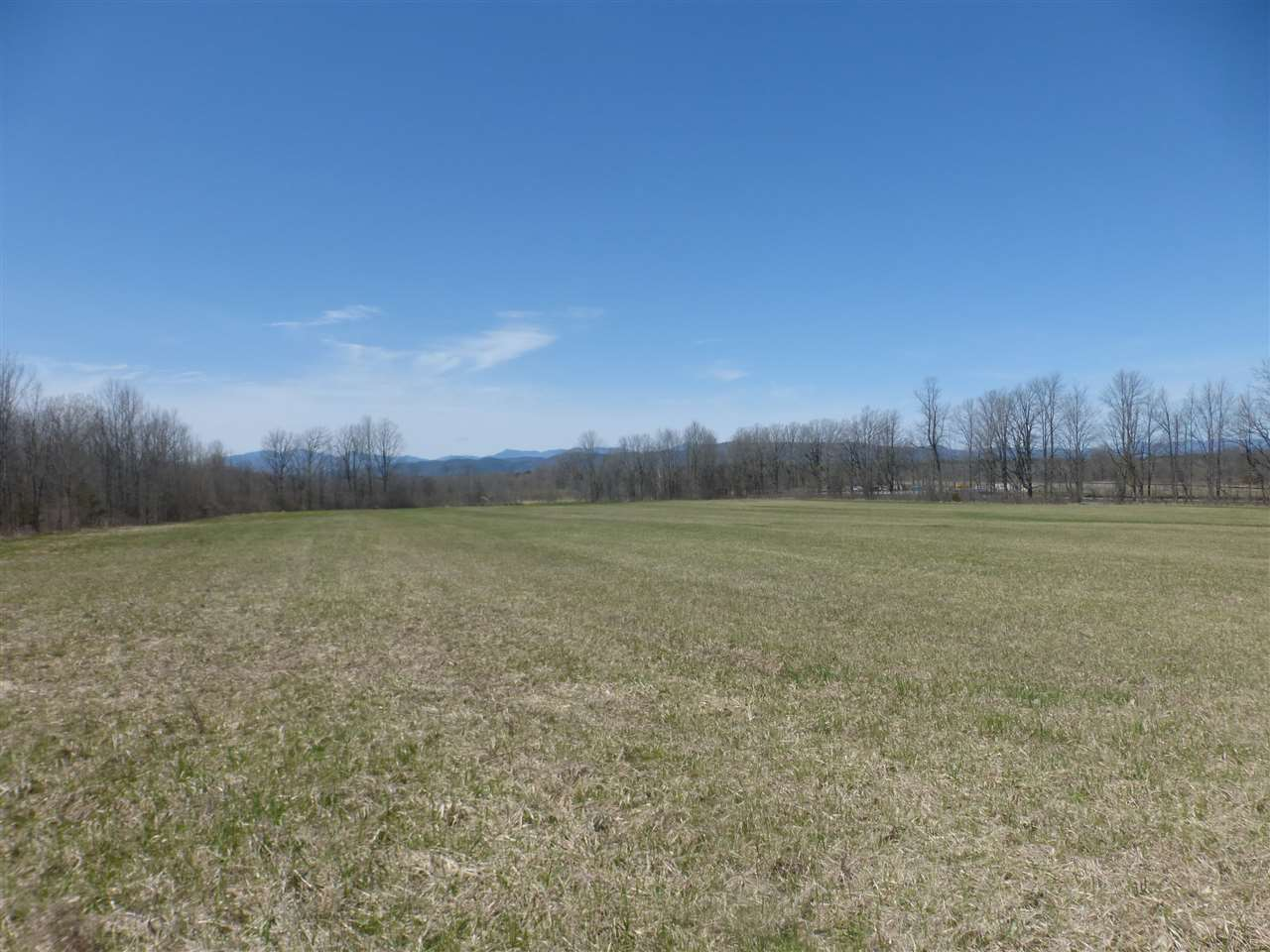 A Rare Find....Almost 65 acres of open & wooded land with 1,000 ft of Rte 7 frontage in Ferrisburgh with spectacular Adirondack views.  Located across from the renowned Rokeby Museum and bordered to the south by conserved land this parcel has endless possibilities.  There is also an easement for right of way from Greenbush Rd.  2 beautiful meadows, this land could be a beautiful gentleman's farm or has good subdivision potential.  Forested land is currently in the land use program.  Conveniently located, 12 miles to Shelburne, 16 miles to Burlington & 16 miles to Middlebury.