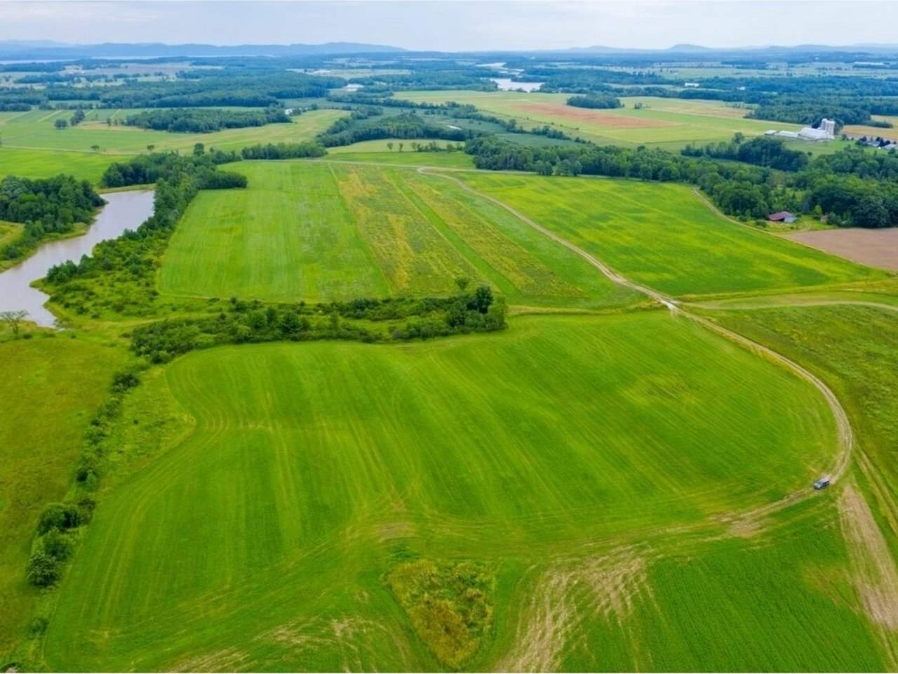 93 acres of prime Addison County farmland!! Currently being cropped for dairy production but would be suitable for a small agricultural farm operation of any kind that requires flat, tillable land made up of prime agricultural soils. The crop land has been conserved with the VT Land Trust but a 5 acres on Norton Town Road has been reserved for a future farmstead site for a new residence and required outbuildings. This is a great opportunity to create your own farm operation from scratch with new state of the art production facilities as well as a new home. Located on a quiet road for privacy, this property would suit any one of a number of alternative farming ventures including a goat dairy, vegetable farm, fruit and nut tree production as well as hemp, hops, and other fiber and grain crops. Become part of the quickly diversifying Vermont agricultural scene in area that supports plants with a zone 5 hardiness requirement.