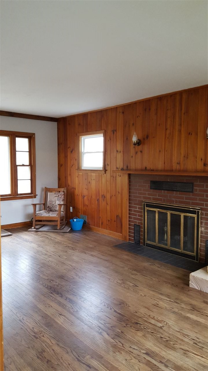 Living Room w/working Fireplace from Entry