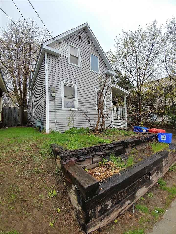 Great owner occupied duplex or investor seeking property looking for great opportunity.  Long driveway for off street parking and very deep lot with shed.  Lots of room.  Full basement with storage and laundry.  Covered porch on side entrance for front 2 bedroom apartment and covered rear patio for studio entrance.  Affordable duplex in nice Winooski location.
