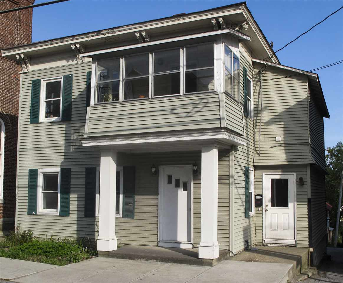 Excellent downtown location . Live upstairs and run your business downstairs or rent to help pay your mortgage. The first floor commercial space has 2 large rooms (could easily be converted back to one) and two smaller rooms for storage in great condition with restroom. The second story is zoned residential with a two bedroom ( one is a walkthrough ) apartment. Two car garage and off street parking is a plus!