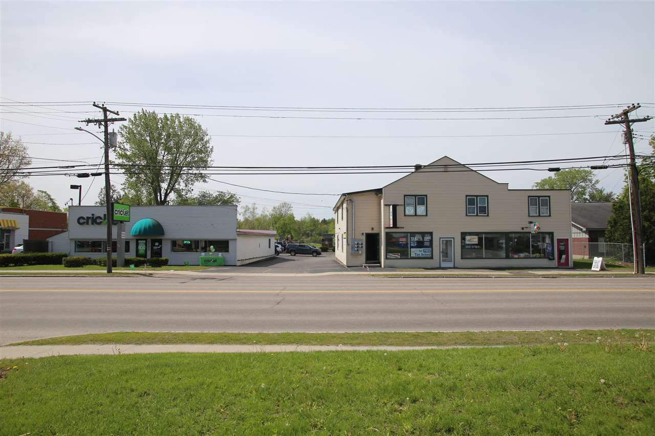 Take advantage of the superb location of this clean and ready to go Commercial and Residential rental complex located in the business district of South Burlington, VT. 10,500 +/- square feet of rental space in 3 separate buildings.  Two lots being sold together with shared driveway access. Property includes (3) Commercial Rental Units and (5) Residential Rental Units.  Site plan shows 31 off-street parking places.  This well managed property produces a gross income of $146,2688 +/- with a net after expenses of $137,784 +/-.  Most of the expenses are covered by the commercial units NNN. Building #1197 has (2) first floor commercial units and (1) first floor residential rental unit.  It then has (3) additional second floor residential units.  It also has a detached 2 bay garage with second floor storage and (1) ground floor residential rental unit.  Building #1203 has (1) large commercial rental unit.  Total acreage for both properties is 0.57 +/- acres.  Come see this amazing property.