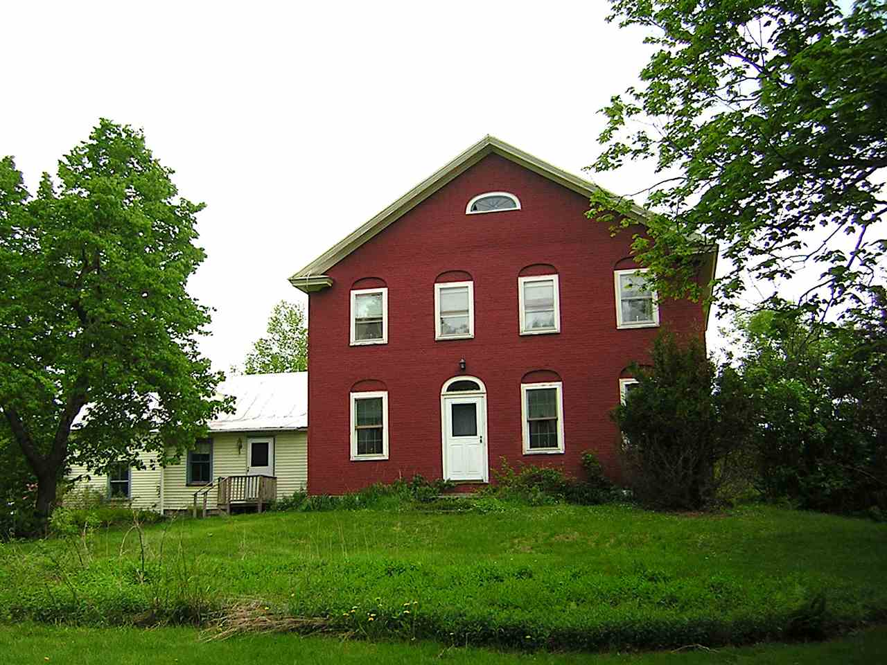 "The 1829 House is an original 1829 brick farm house and barn with spectacular river and mountain views. The farm house has 4 bedrooms upstairs and 2 baths and has been rented until recently. Custom moulding and trim with built ins. Hardwood floors on the first floor with painted wide pine upstairs. Lamoille River views in the foreground with mountain views in the background. Beautiful period fireplace surround and mantel in living room. East access to the Rail Trail and Rt 15 by Right of Way and  the property is set back from Rt 15. This house presents a great restoration opportunity of a seldom found antique brick farm house.  In addition there is a large barn in exceptional condition that has been used as a retail antique center called ""Rewind Time to 1829"".   The 3- level barn was constructed in 1900 and measures 46' x 100'.   The barn has been used as a commercial retail showplace and store.  The barn is wired, partially heated and is in very good condition.   Spectacular river and mountain views from the house, barn and around the 2 acre property.  This property is a must see for anyone looking for an original antique to call their own.  The future of the 1829 House could be a lot of things including retail, residential, wedding venue, or a Rail Trail Bike Destination."