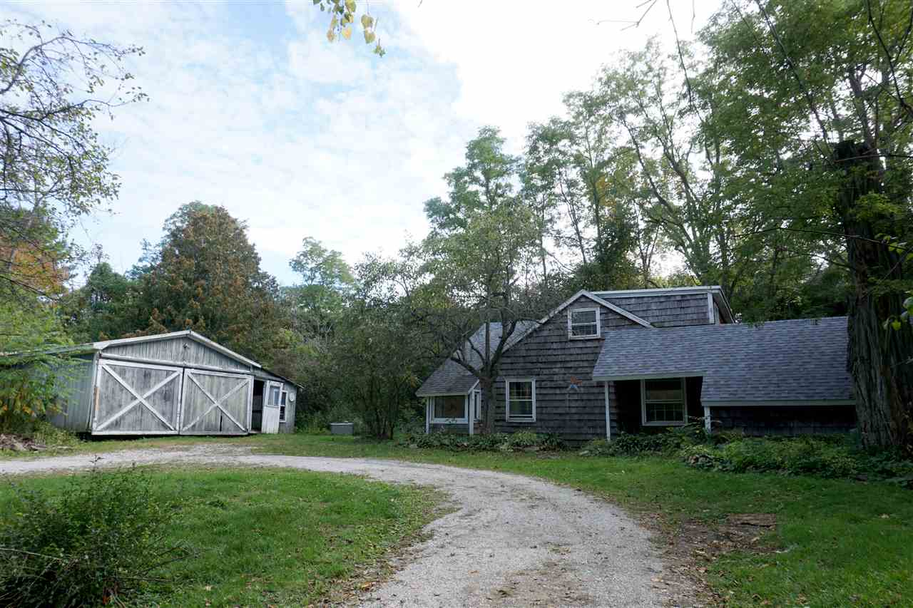 Fantastic location in popular Shelburne. 4.37 acres both open and wooded. Current home needs renovation or tear down. Well and septic serve the home. Barn/garage as is. Quick drive into Shelburne village, schools and shopping.