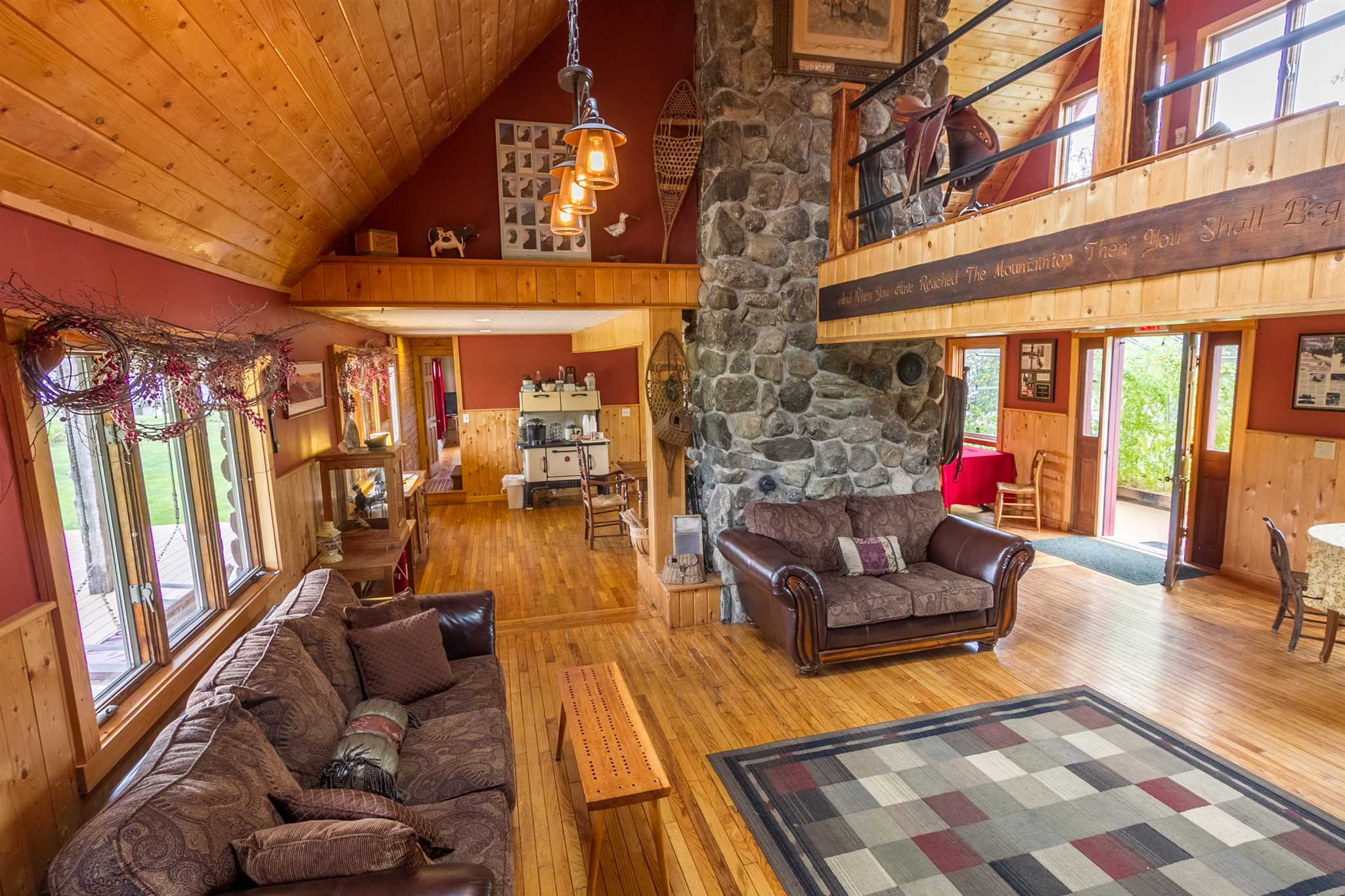 What a great package! This 6 bedroom log home, with chefs kitchen and vaulted ceilings is paired with a gorgeous 3 story barn having 9 stalls, and tack room with a function hall and 2 generous apartments overlooking 16 acres of fenced pasture with dressage ring. With your very own solar field surrounded by fruit trees and plenty of garden space you're on the right path to sustainability! Circular driveway, with attached 2 car garage and additional open air storage provides a convenience much appreciated. This piece of heaven is a short distance to all amenities including schools, health car, shopping, dining and more. Don't forget the recreational opportunities too! The snowmobile corridor is close by, and hiking, biking and skiing is just out your door - and that river, what an opportunity for rafting and fishing! Looking for MORE land? Check out this same great property with 70+ additional acres for $649,000 under MLS 4788940!