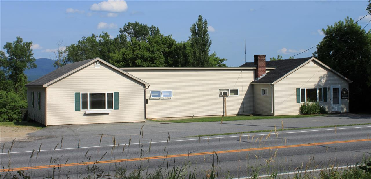 Price Reduced $50,000 - motivated sellers! Highly visible commercial property on heavily traveled Route 30 just south of Middlebury. This property has a view to the east of the Green Mountains and has been home to a variety of business and organizations over the years. The flexible space is currently set up as office space. It features 6-7 individual offices, two conference rooms, several utility rooms, two baths (1 half, 1 full), a full basement for storage, and an attached very large garage along the back side of the building accessible through two over-sized overhead doors. There is a paved parking lot in the front of the building that will accommodate approximately 6 cars, with a gravel drive to the rear of the building where additional parking is available. The building currently has one tenant, a large animal veterinary practice, that occupies approximately 75% of the space. The tenant is not on a long term lease if a new owner wishes to occupy the entire building but they may consider one for an investor client.