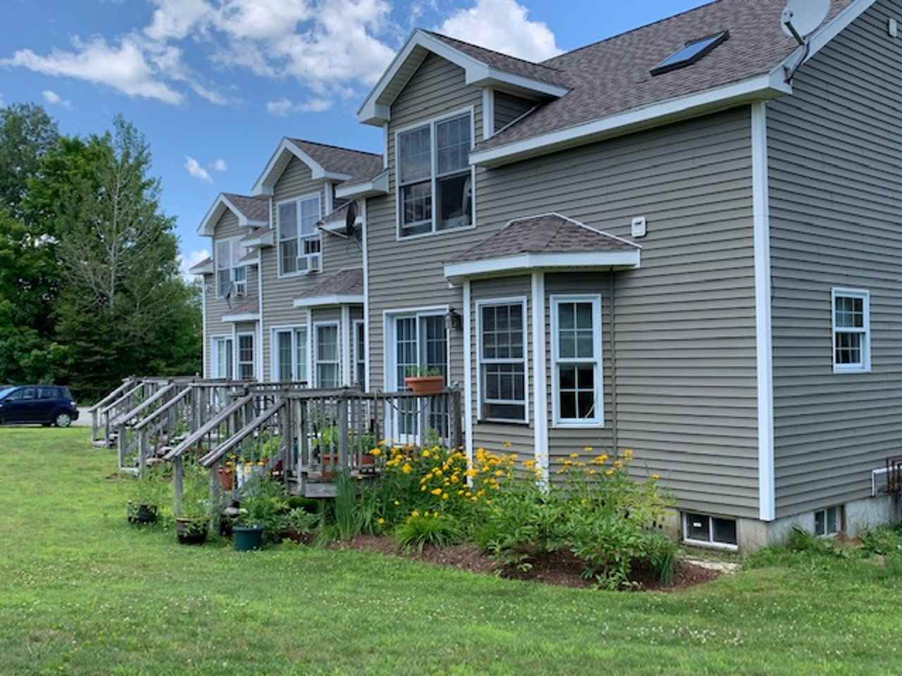 "3 unit Townhouse Condominium, 2BR 1.5 bath each. Full kitchen with spacious island, DR, LR on first floor. Large covered porch and deck off rear to lawn area. each unit has flower gardens front and back. Full insulated basement. All units are currently rented with annual leases in effect. 5 minutes to Smugglers' Notch Resort, 45 minutes to Jay Peak Resort. 30 minutes to St Albans, and 45 minutes to Essex Jct, and Global Foundries Sited on individual lot ideal for ""owner occupied"" financing. Appraisal from August 2018 available for review. Built in 1998. Propane heat, New Septic 2016. new roofs 2018. Near 100% rental occupancy. Interior trim and doors are natural wood."