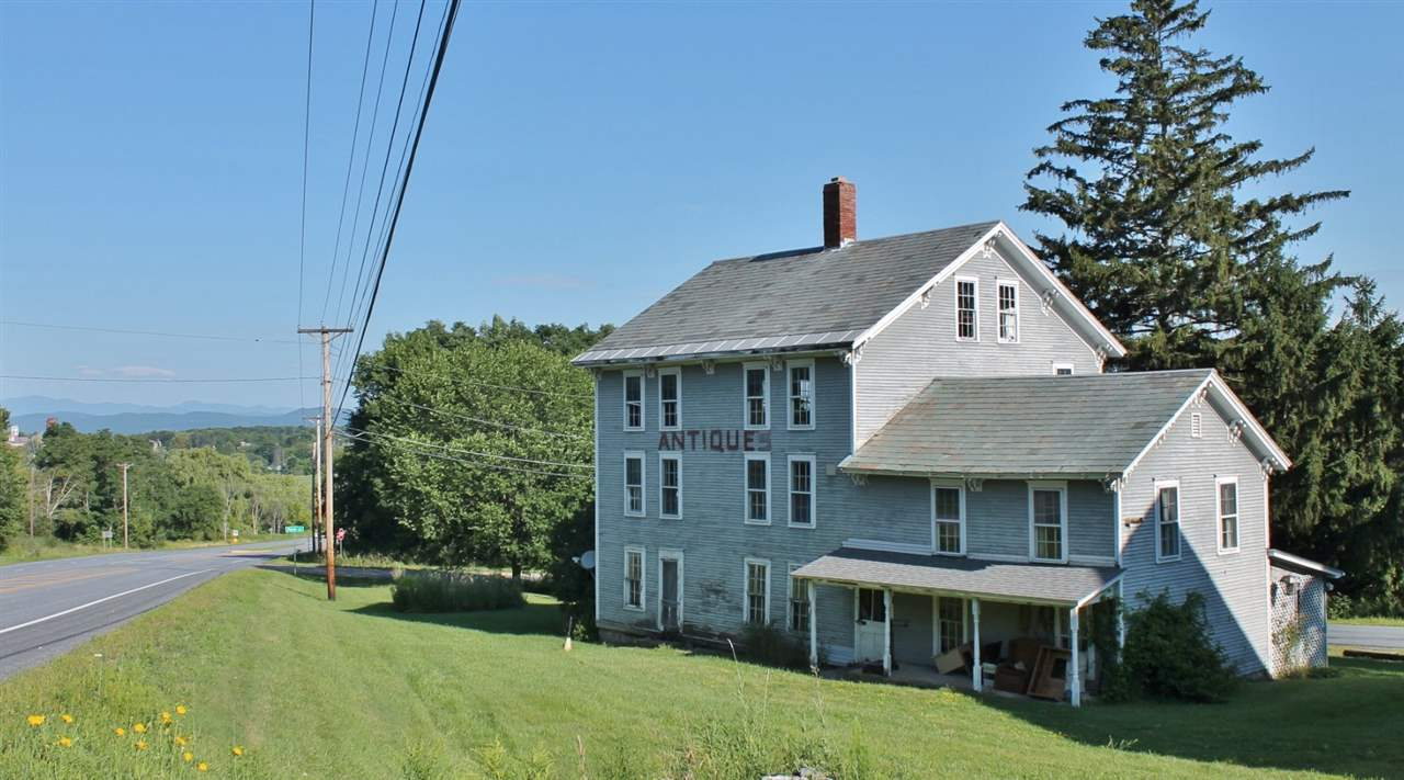 Opportunity Awaits! This vintage colonial was built in 1878 and has served many purposes throughout its life in the mountain valleys of Central Vermont. From a doctor's office, to a family home, to a bustling antique shop - it's now time for a new purpose. The property has Route 7 access and frontage, municipal water, slate roof, a post and beam barn, and a detached oversized garage. The rooms on the first floor of the residence were most recently used as both restoration and workshop space for the antique business. The second and third floors were living quarters. Spacious and open attic above that! Property is zoned for both residential and some specific commercial applications - Perhaps a group home, bed and breakfast or home based occupation. Location offers high visibility and traffic count from Route 7 and over 2 acres of land with northwestern views of the Adirondacks. Sellers are motivated as property needs extensive rehabilitation!