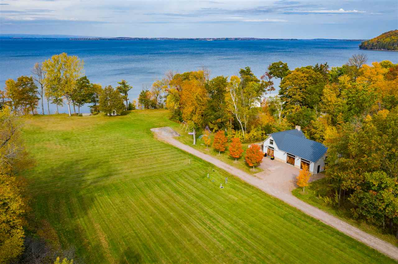 Rare opportunity to own one of the most spectacular beach front properties along Lake Champlain. With 558 Feet of sandy beach, 18.5 acres and captivating views of the Adirondack Mountains.  A private, serene setting for your future home. The perfect lot to site your dream home and all the prep work is done. A state-of-the-art guest house on the property is already built, with standing seam roof, top of the line finishes throughout, custom chefs kitchen with Viking Appliances, extra-large granite island, living room with wood burning fireplace.  A spacious and tranquil second level with stunning views of the lake is a relaxing retreat.  An over-sized 2 car heated garage finished with wood paneled walls and ceiling serves many purposes for lake front living. The property was once the home of Camp Tara, a beloved Summer retreat for children on the shores of Lake Champlain. The original Chapel still stands along the edge of the property facing west, with charming wood floors and interior, stone hearth and wood burning fireplace. A step back in time. Perfect now for entertaining friends and family at the beach or a relaxing yoga studio by the lake. If you have been searching for the perfect spot to build your dream home, look no further. This lot is level and has clear views of the lake, surrounded by trees along both sides and a private wooded driveway entrance.  Permits are in place for a single-family home with a 7-bedroom capacity, including the guest house.
